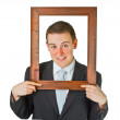 Businessman with wooden frame — Stock Photo