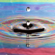 Psychedelic Drop in Serene Water — Stock Photo