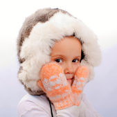 The little girl in a fur cap — Stock Photo