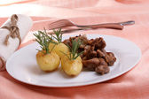 Some grilled goulash and organic herbed potato — Stock Photo