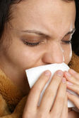Young woman has a cold and one tissue — Stock Photo