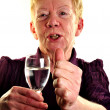 Stock Photo: Old age womis holding glass of water