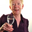An old age woman is holding a glass of water — Stock Photo #4039605