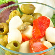 Some fresh organic garlic salad with green olive — Stock Photo #4089055