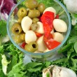 Some fresh organic garlic salad with green olive — Stock Photo