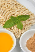 Home made noodle and some flavour powder — Stock Photo