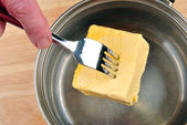 Prepare some organic butter to bake a cake — Stock Photo