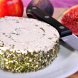 Stock Photo: Herbed soft cheese on white plate with knife