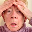 Royalty-Free Stock Photo: One old woman has a painfull headache
