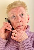 One old woman is talking on a telephone — Stock Photo