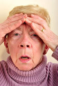 One old woman has a painfull headache — Stock Photo