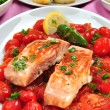 Grilled salmon with organic tomato and parsley — Stock Photo