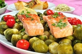 Grilled salmon with organic brussel sprout on a plate — Stock Photo