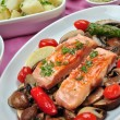 Grilled salmon with organic mushroom on a plate — Stock Photo