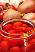 Some organic red tomato in sunflower oil — Stock Photo