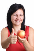 A young woman holding one organic apple — Stock Photo