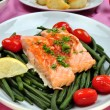 Grilled salmon with organic beans on a plate — Stock Photo