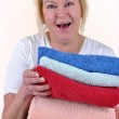 Woman in her 50's with some hand towls — Stock Photo