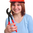 Young woman holds a water pipe wrench — Stock Photo