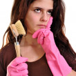 A young woman with a brush and gloves — Stock Photo