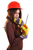 Young woman with helmet holds a srewdriver — Stock Photo