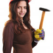 Young woman with helmet holds a hammer — Stock fotografie