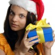 A young woman carries a christmas hat — Stock Photo