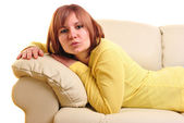 Young woman is lying on a couch — Stock Photo