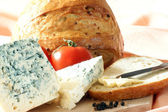 Timber board with some blue mold cheese — Stock Photo