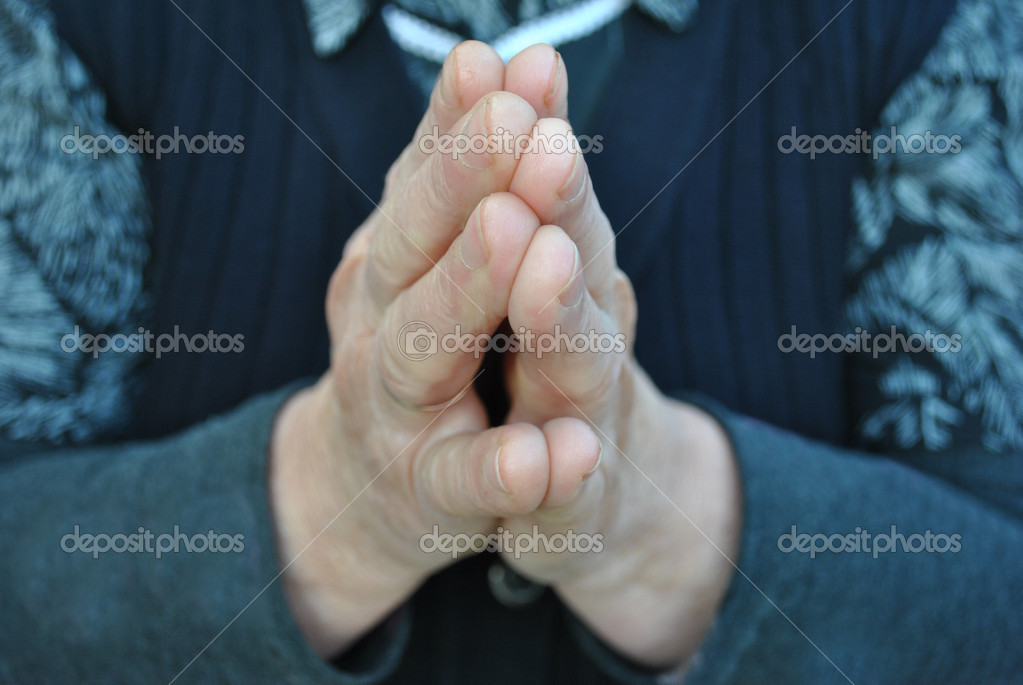 One old person is praying in silence — Stock Photo #5126423