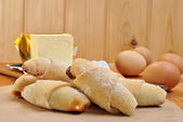 Some home made crescents, magarine and eggs — Stock Photo