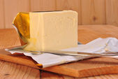 A cube margarine and a kitchen knife — Stock Photo