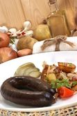 Home made black pudding with grilled potato — Stock Photo