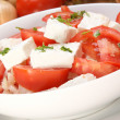 Organic Greek salad in a white bowl — Stock Photo