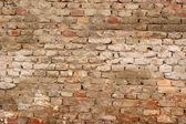 Stone wall with cement prior to plastering — Stockfoto