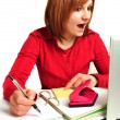 Stock Photo: Office assistant in red blouse makes notes