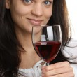 Red wine is consumed from a glass — Stock Photo