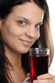 Cherry juice is consumed from a glass — Stock Photo