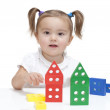 Little girl playing with blocks — Stock Photo #4247733