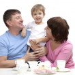Mature couple with grandchild — Stock Photo