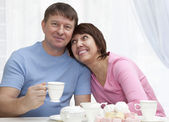 Elderly couple have a breakfast — Stock Photo