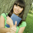 Female in a park with a notebook — Stock Photo