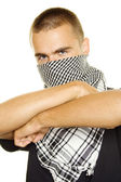 Young man in a Palestinian scarf — Stock Photo