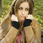 Girl with headphones fall — Stock Photo #4054829
