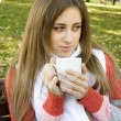 Girl holding coffee cup — Stock Photo