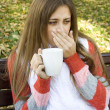 Girl holding coffee cup — Stockfoto #4054970