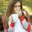 Stock Photo: Girl holding coffee cup