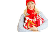 Young woman holding many gift boxes — Stok fotoğraf