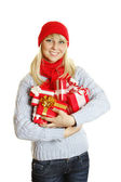 Young woman holding many gift boxes — Stock Photo