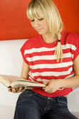 Women Reading a Book on Sofa — Stock Photo